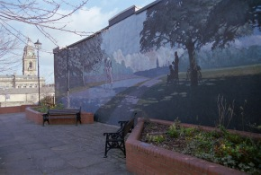 The Beryl Burton memorial mural in Morley, with the town hall dominating the skyline in the background
